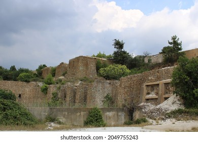 Old destroyed buildings at the mines of Vavdos, overtaken by nature - Shutterstock ID 2049755243