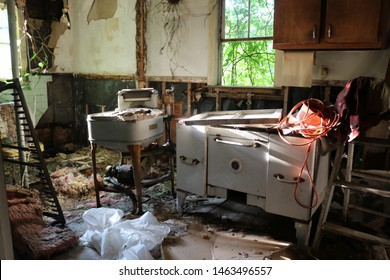 Old destroyed messy vacant abandoned kitchen in house