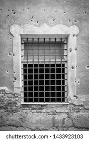 Old Detention Room Window Exterior Surrounded By Bullet Holes