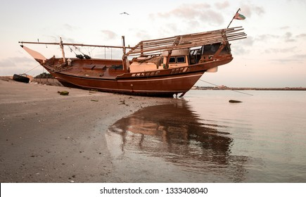 old dhow on a beach in Ras al Khaimah, United Arab Emirates