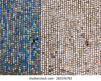 Old diagonal colorful mosaic texture on the wall. Landscape style. Great background or texture.