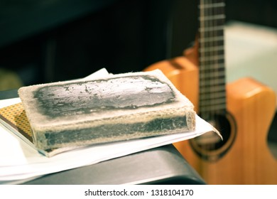 the old diary is next to the guitar, a set of lyrics for performances on stage