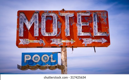 An old dicrepit, flaking neon motel sign in the American Desert