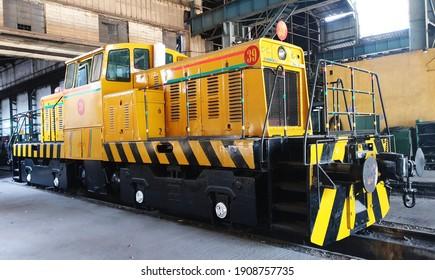 Old diesel locomotive parked in a locomotive shed