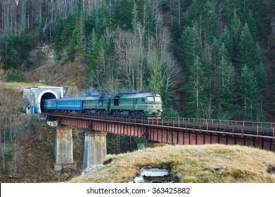 Old diesel passenger train in tunnel. Mountain railroad in Yaremche, Ukraine