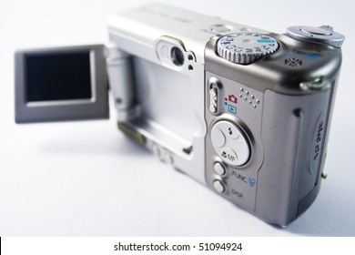 An old digital camera on white background.