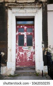 Old dilapidated doorway in need of a little redecoration.