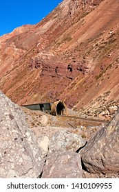 Old and dilapidated train tunnel over abandoned roads in the Andes Mountains. Puente del Inca. Mendoza. Argentina.