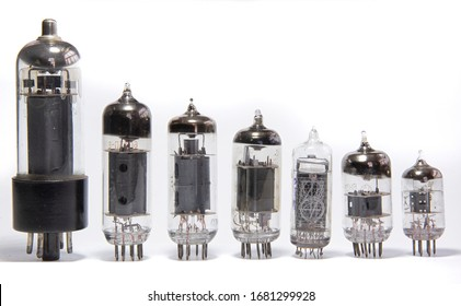 Old diode lamps of different sizes in the studio on a light background