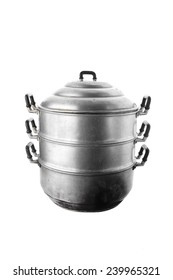 Old and dirity  steaming pot isolated on white.