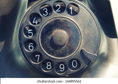 old dirty black retro telephone disk dealer