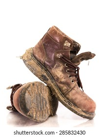 Old and Dirty boots in mud. on white background