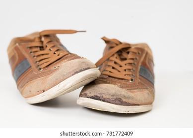Old dirty brown sneakers