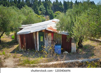 old dirty corrugated iron shack in a mediterranean landscape