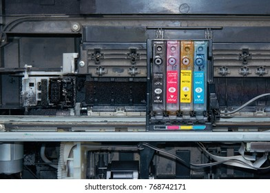 Old, dirty, disassembled ink jet printer. View of internal parts. Closeup