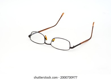 Old and dirty eyeglasses isolated on white background.