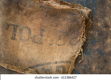 Old dirty hessian sack bag stamped used as upholstery material background