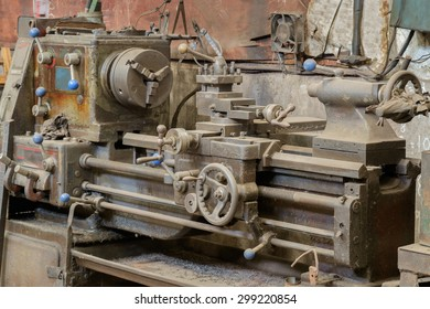 Old and dirty lathe machine.