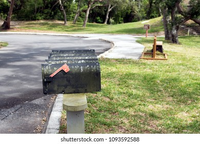 Old dirty mailboxes lined up