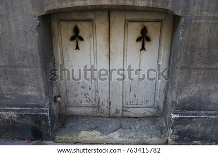 Old And Dirty Metal Cave Door In The City By The Street