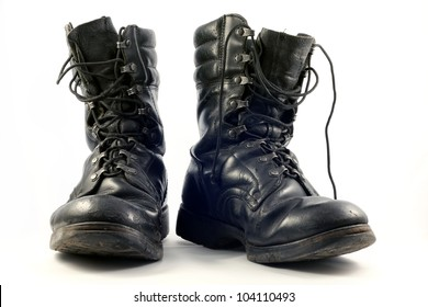 Old and dirty military shoes on white background