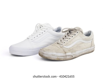 Old dirty and new white sneakers isolated