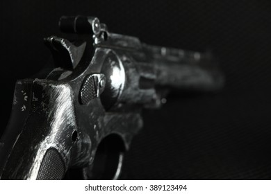 The old and dirty plastic toy gun represent the crime and weapon concept related idea.