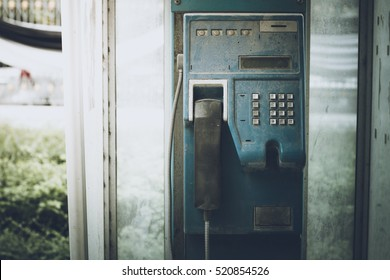 old and  dirty public telephone