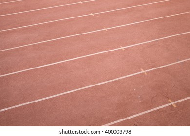 Old and dirty running track in small town