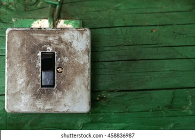 Old dirty switch on wooden wall, closeup, text space