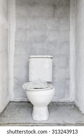 Old dirty Toilet and new white wall background
