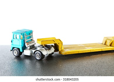 Old and dirty trailer truck die cast toy model represent the transportation toy model concept related idea.