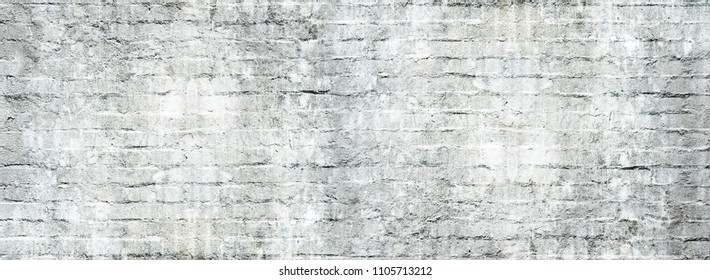 Old dirty white brick wall for texture or background, panoramic view.