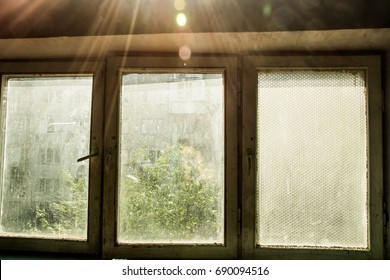 Old dirty window with a green frame, low-lying, open
