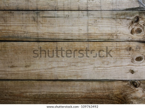 Old dirty wooden boards destroyed by time and weather