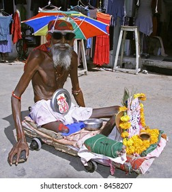 old disabled beggar in pushkar, rajasthan, india
