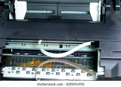 Old disassembled printer dries ink jet view of parts.