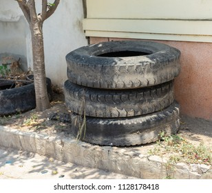 Old discarded dirty car tires.