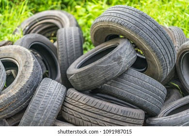 Old discarded used tires in a heap.