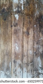 Old discoloured gray wooden floor with water damage  stains