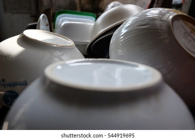 Old Dishes & Other Tableware placed on a old  wooden shelf