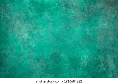 Old distressed green backdrop, grunge background or texture