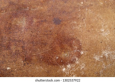 old distressed stained and scuffed leather background texture