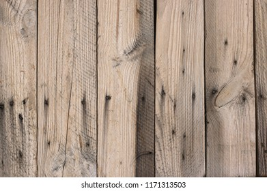 Old distressed weathered wood board texture as background.