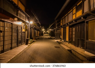 Old district wooden houses at historical Takayama town in night at gifu japan.