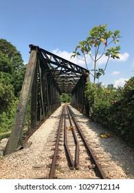 Old disused railway bridge with railway track and sleepers intact, once belonging to Keretapi Tanah Melayu,  in Bukit Timah, Singapore.