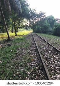 Old disused railway track in asia showing iron tracks.