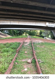 Old disused railway track under a flyover in asia.