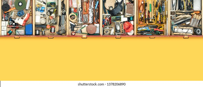 Old do it yourself work tools in drawers top view, DIY and repair concept, blank copy space