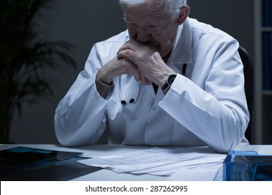 Old doctor with deep depression crying in solitude
